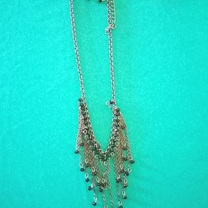 .Black dangly bead necklace with dangly earrings